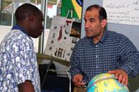 Man showing student globe