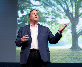 """Image of Mark Perna doing a presentation on """"Unleashing Passion and Purpose in Younger Generations."""""""