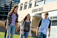 Students walking outside Cedar Hall